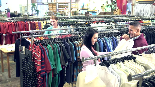 People shopping in clothing store video