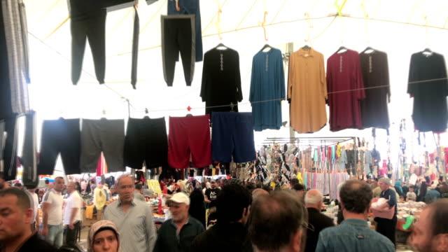 people shopping in street market, may 26, 2019, istanbul, turkey - grand bazaar video stock e b–roll