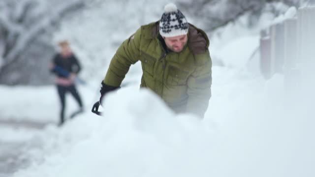 HD: People Shoveling Snow