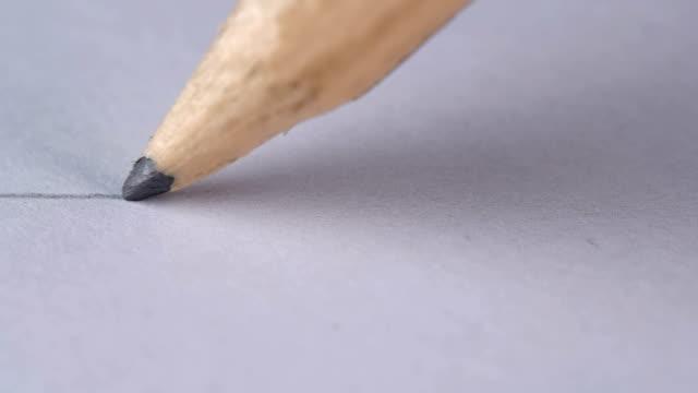 personer enkel penna ritar en rak linje på ett vitt ark - blyertspenna bildbanksvideor och videomaterial från bakom kulisserna