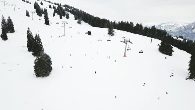 people skiing and snowboarding on snow slope in winter ski resort. - hautes alpes stock videos & royalty-free footage