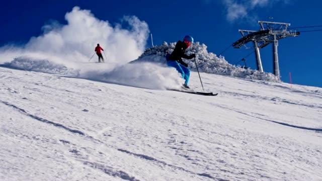 SLO MO People skiing down ski slope video