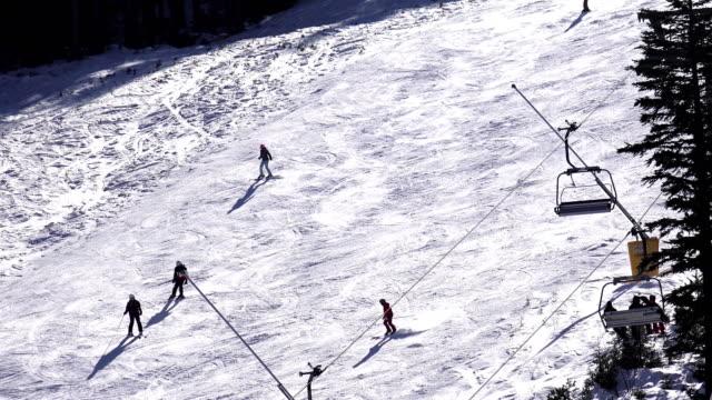 People Skiing on Ski Slope, 4K video