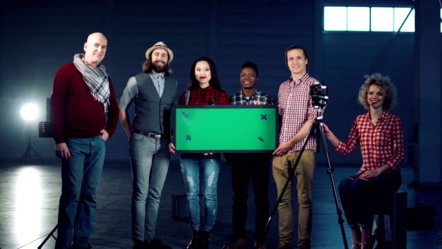 People standing with chromakey board video