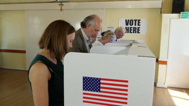 4K: People stood at Polling / Voting Booths at USA Elections or Referendum