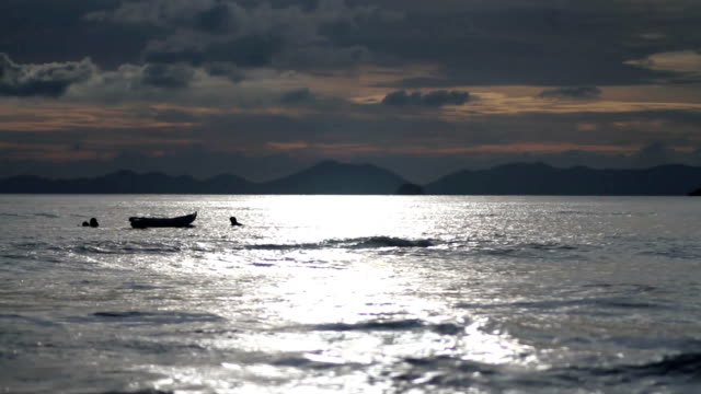 people swim near the boat into the sea - sky diving video stock e b–roll