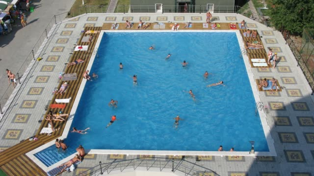 People swimming in pool. Time lapse video