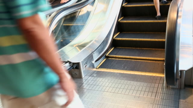 People taking escalator in a shopping mall video