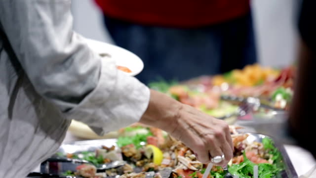 HD: People taking food from a buffet video