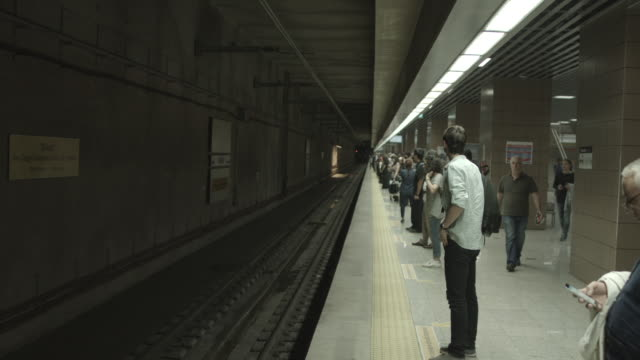 people timelapse in railway station in Istanbul, Turkey. June 12, 2015 people timelapse in metro station in Istanbul, Turkey. June 12, 2015 subway station stock videos & royalty-free footage