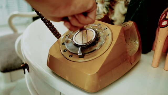 4K. people use finger dialing an retro rotary vintage style telephone. film dye for vintage tone. old telecommunication technology 4K. people use finger dialing an retro rotary vintage style telephone. film dye for vintage tone. old telecommunication technology telephone receiver stock videos & royalty-free footage