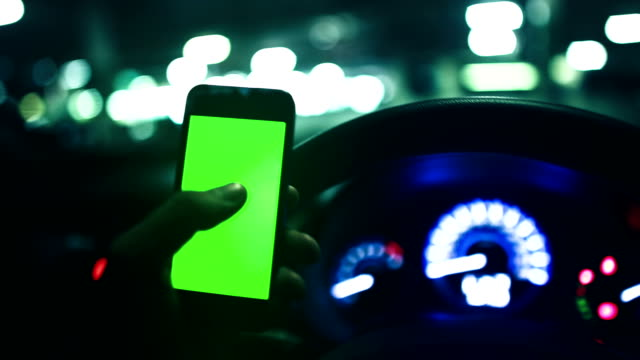 People using a smartphone on car ,green screen video