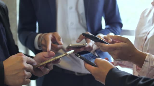 People using Smart phone sharing, Social Media