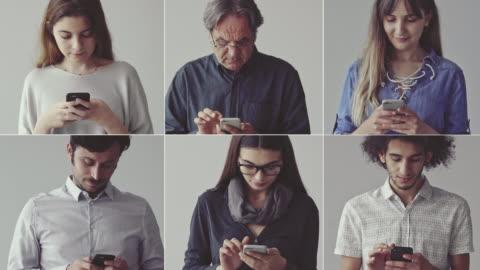 persone che usano il telefono cellulare - people video stock e b–roll