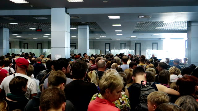 People waiting at passport control video