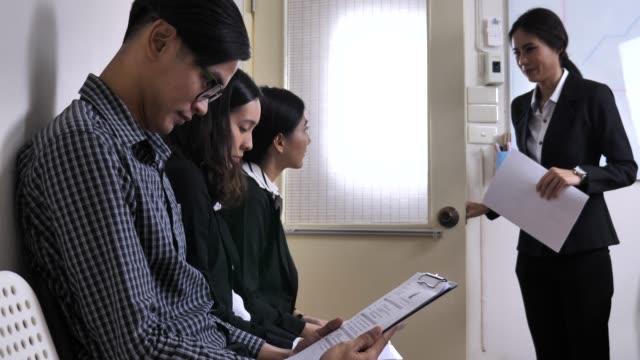 people waiting job interview - indennità video stock e b–roll