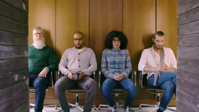People waiting nervously for job interview
