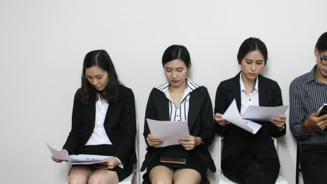 People waiting nervously for job interview video
