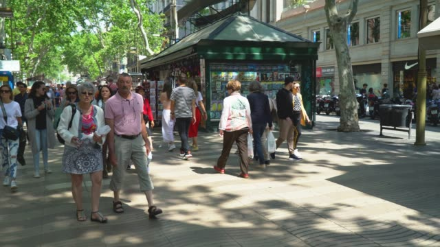 People walk down the street