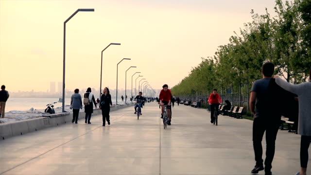 People walk in Maltepe coastal park video