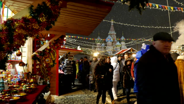 People walk on New Year Fair in Moscow on Red Square. video