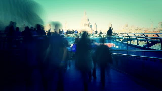 People walk on the Millennium Bridge video