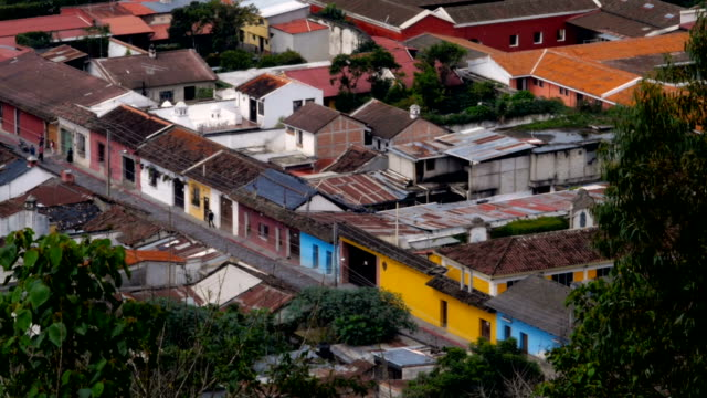 People walking down the colorful streets of Antigua shot from above video