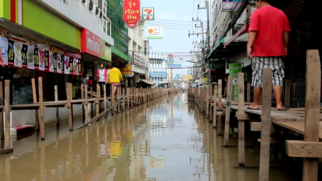 People walking during the monsoon flooding in Thailand video