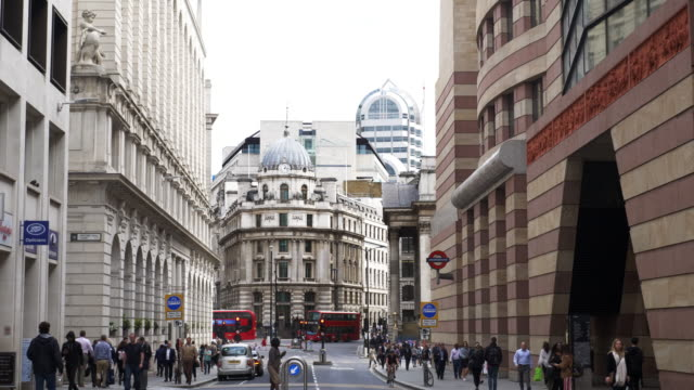 people walking in poultry street in the city of london - post modern architecture stock videos & royalty-free footage