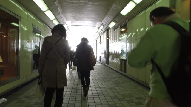 People walking in the tunnel
