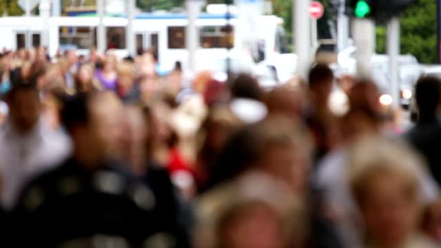people walking on city street video