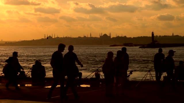 People walking on the coast in Kadikoy. İstanbul Turkey