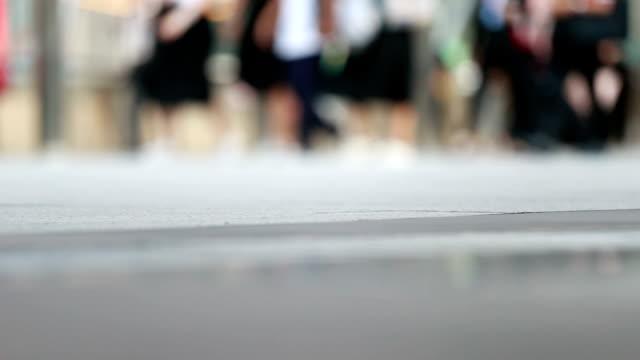 People walking on the sidewalk, slow motion video