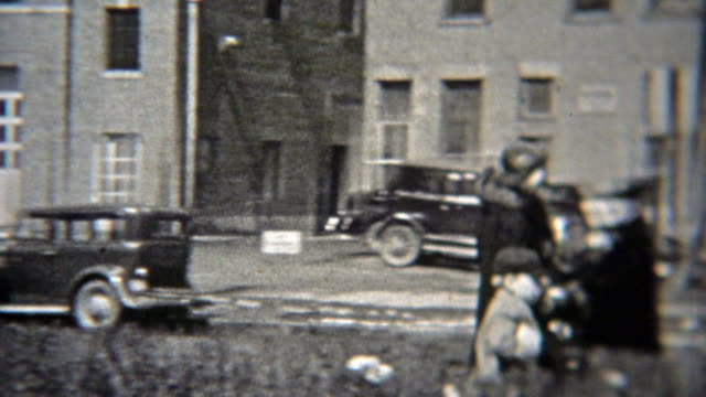 1937: People walking past old telegram building downtown. video