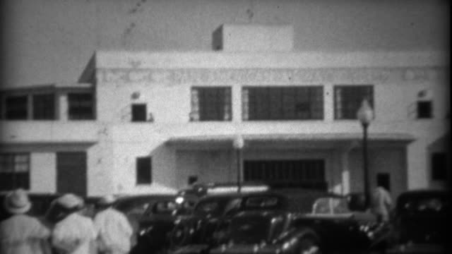 1935: People walking to the Pan American Airways System building. video