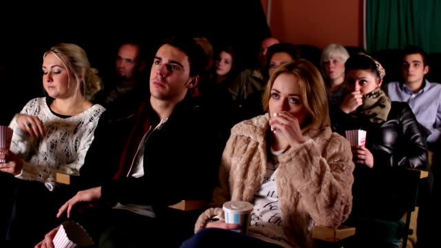 People watching a sad movie at the cinema / Theatre video