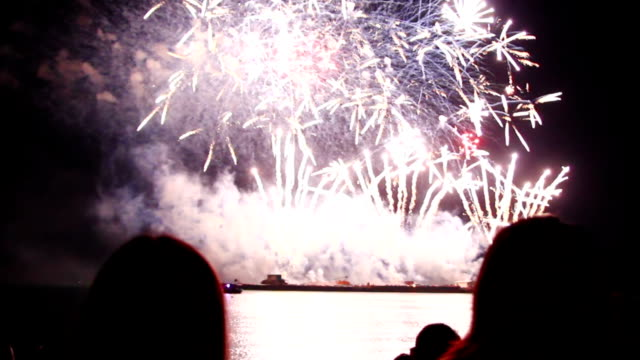 people watching epic fireworks at beach - happy 4th of july stock videos & royalty-free footage