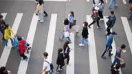 istock People wearing masks walking on zebra crossing 1287658775