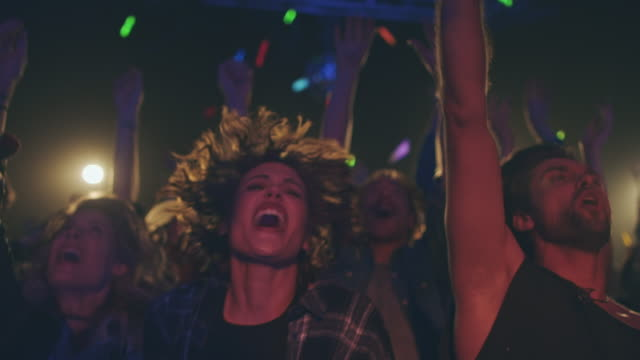 People with Glowsticks Crowd on concert waving with glowsticks in various colors.   rock music stock videos & royalty-free footage