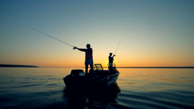 stockvideo's en b-roll-footage met mensen met staven op een boot, close-up. - boat