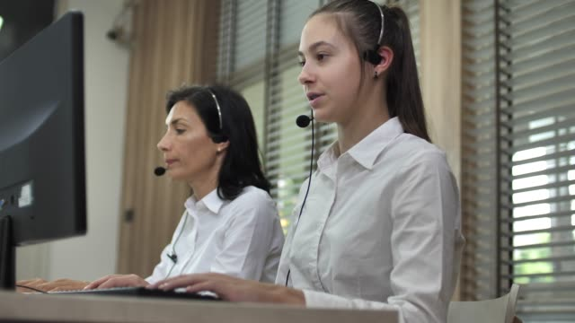 People Work At Contact Center. Woman In Headset talking to Customer