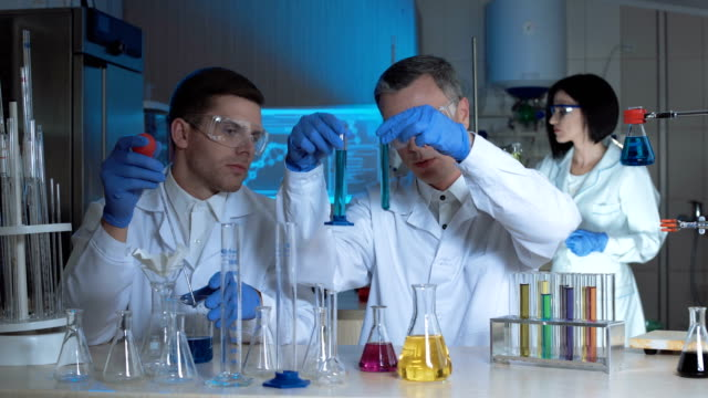 People working in laboratory together video