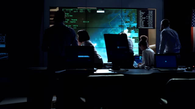 people working in mission control center - controllo video stock e b–roll