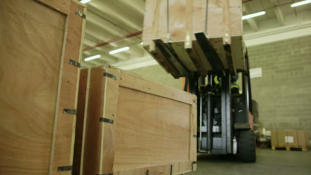 People working in warehouse, workers and industry video