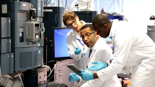 People working with Specialist Scientific Equipment in a Laboratory video