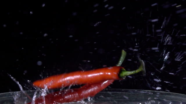 pepper pouring in water Slow motion video