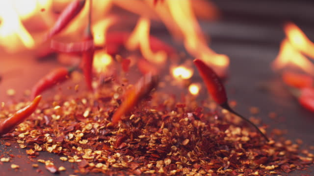 Peppers and flames Peppers and flames in super slow motion, shot on Phantom Flex 4K spice stock videos & royalty-free footage