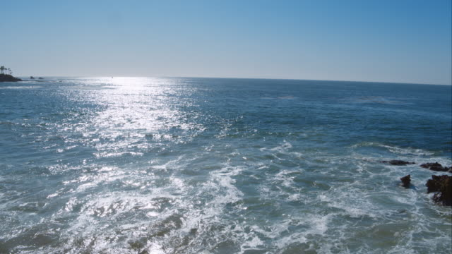 Perfect aerial wide shot of a Malibu California beach with white water waves crashing on the sand from a helicopter point of view showing the sea and coastline in Los Angeles, United States video