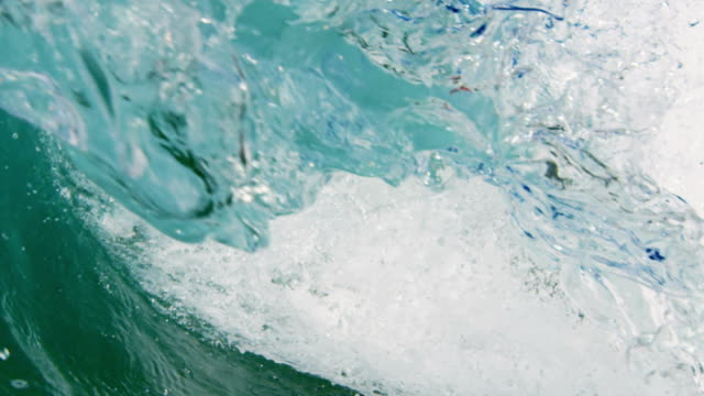Perfect detailed beautiful wave POV as wave breaks over camera on shallow sand beach in the California summer sun. Shot in slowmo on the Red Dragon at 300FPS. video