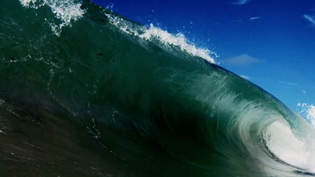 Perfect huge barreling wave POV as wave breaks over camera on shallow sand beach in the California summer sun. Shot in slowmo on the Red Dragon at 300FPS. video